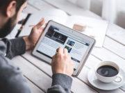 Man Reading Touchscreen Blog Digital Tablet