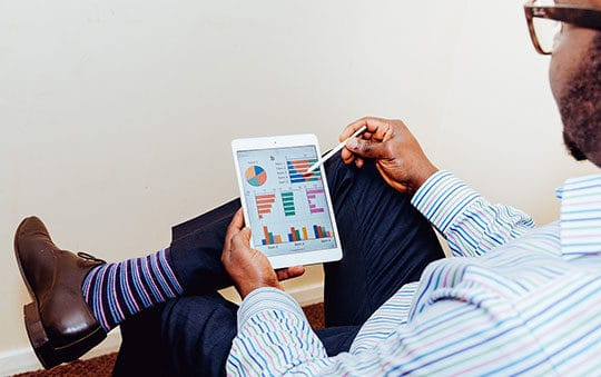 person-man-business-tablet-charts-reports-record