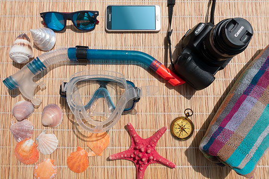vacation-travel-sunglasses-smartphone-camera-diving-mask-snorkel-compass