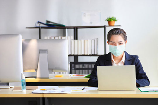 employee-mask-work-social-distance-business-office-coronavirus-covid19