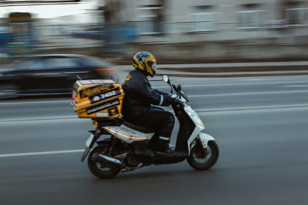 motion-blur-on-time-delivery-vehicle-transport-motorcycle-scooter